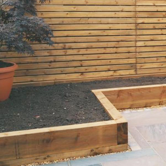 Raised flower beds by Outside Space Landscaping & Design